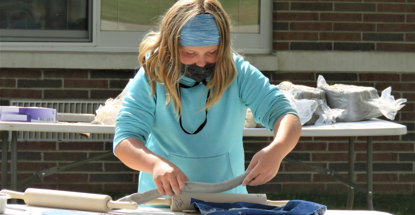 A Page 5th grader works on a pottery project.