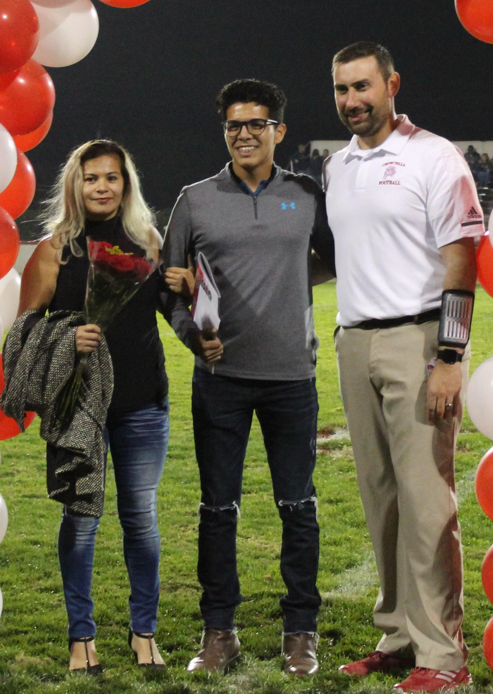 Kristean Robles and his supporters at Senior Night.