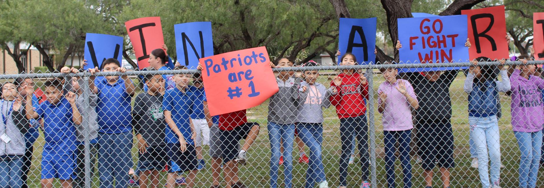 students with signs