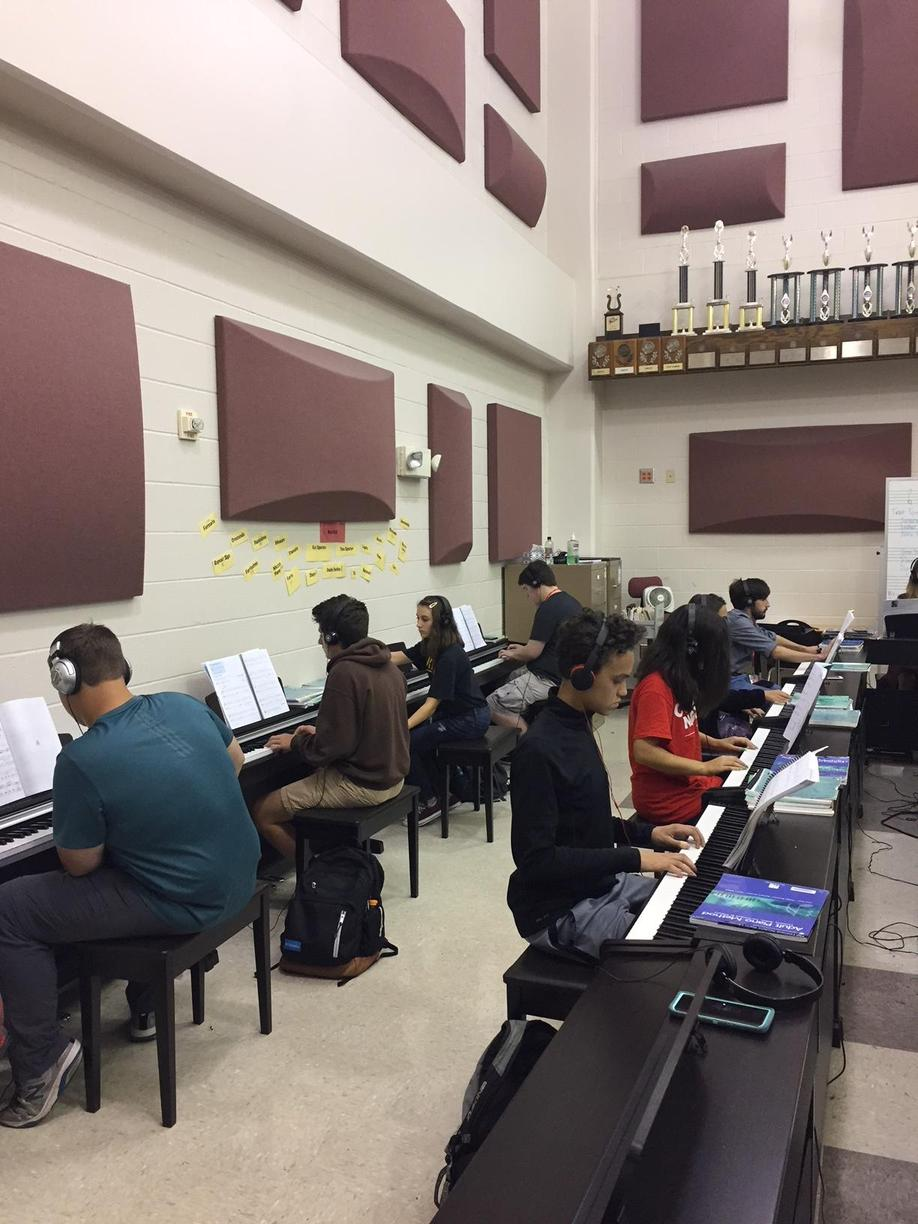 Classroom of students in piano lab