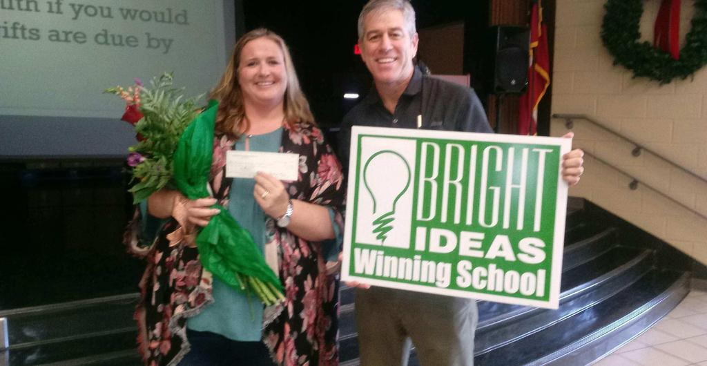 Mrs. Kelly Smith accepting her check for winning the Bright Ideas grant!