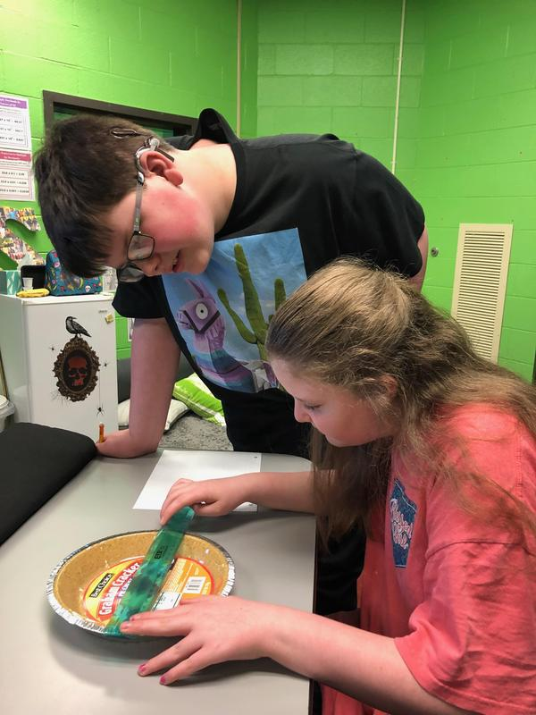Students measuring a pie crust