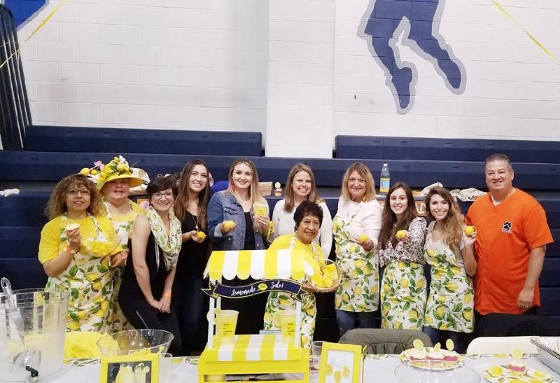 Washington School staff at their lemonade display table