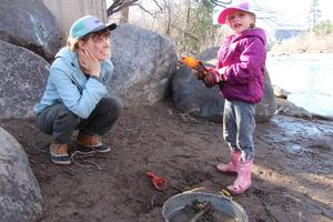 Preschool teacher, Sarah Lemcke, working with a student at the Animas River.