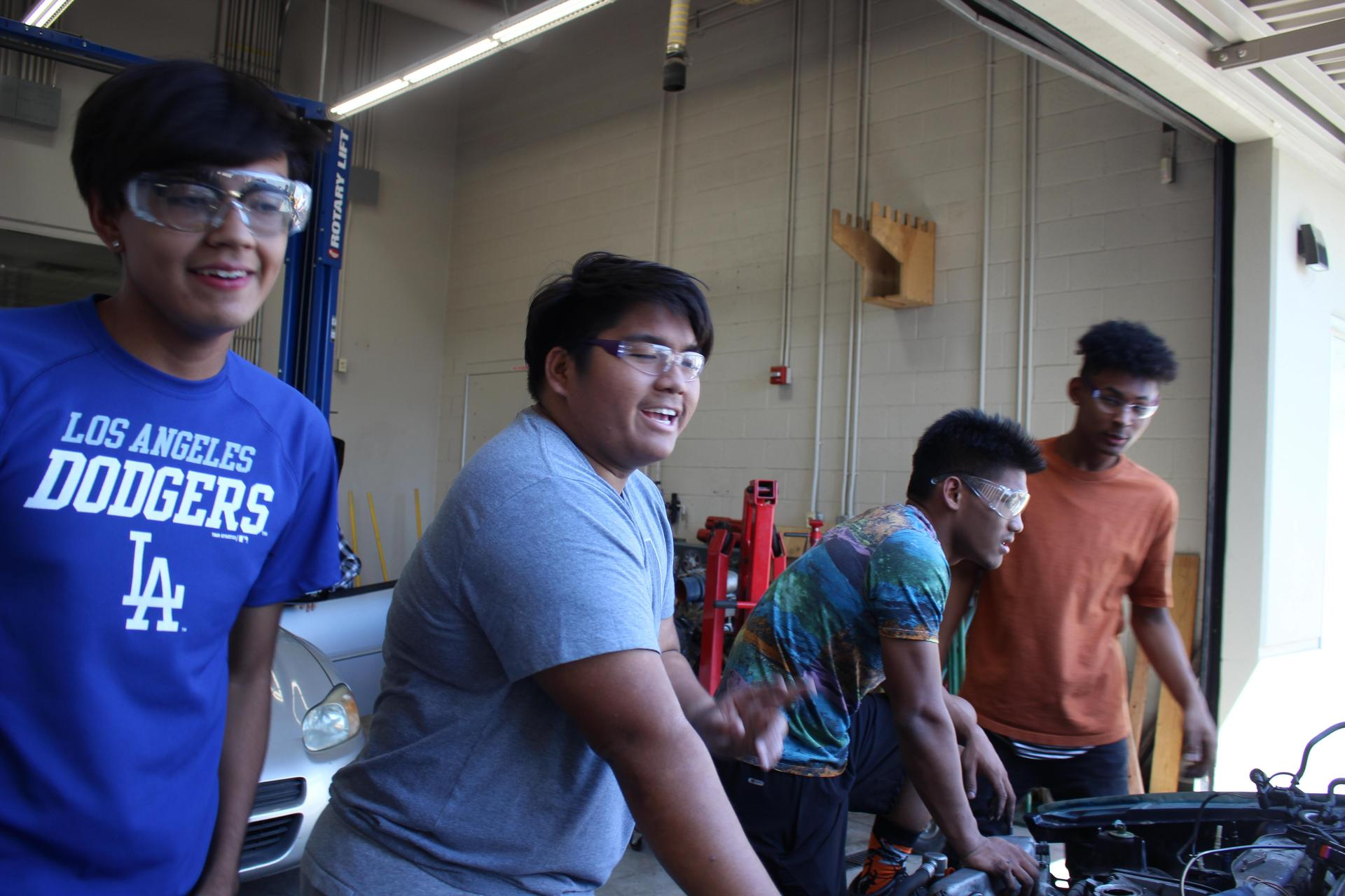 Group of students in the auto shop