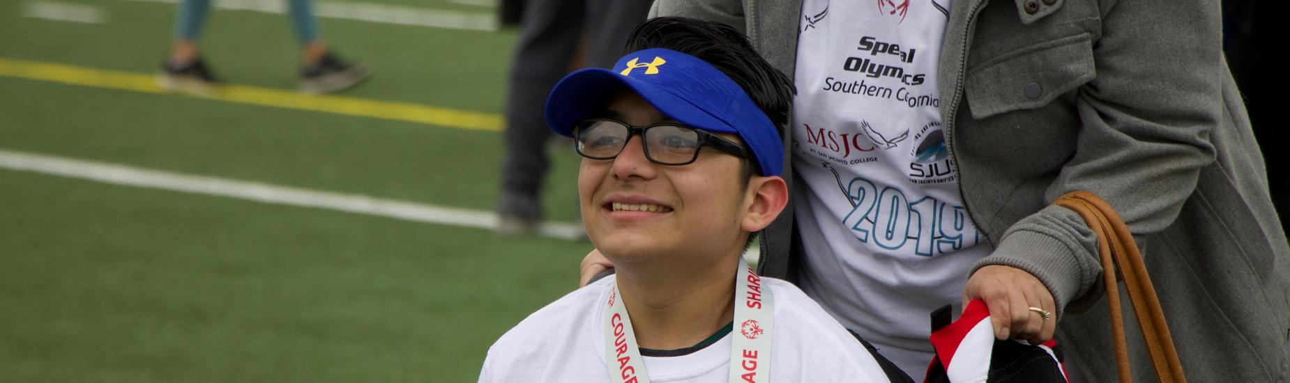 Student-Athlete Smiling After Winning a Medal at the Special Olympics
