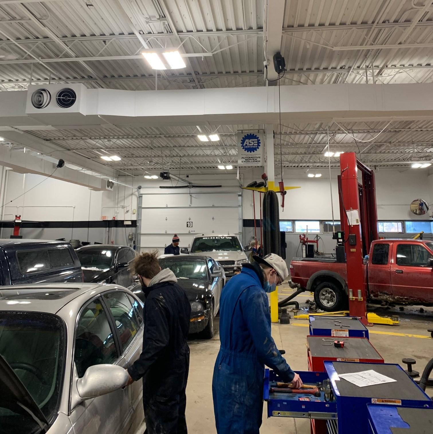 Auto students working in the auto shop