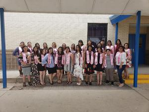 VMHS Cosmetology students that received license and their pink stole that was worn at graduation.