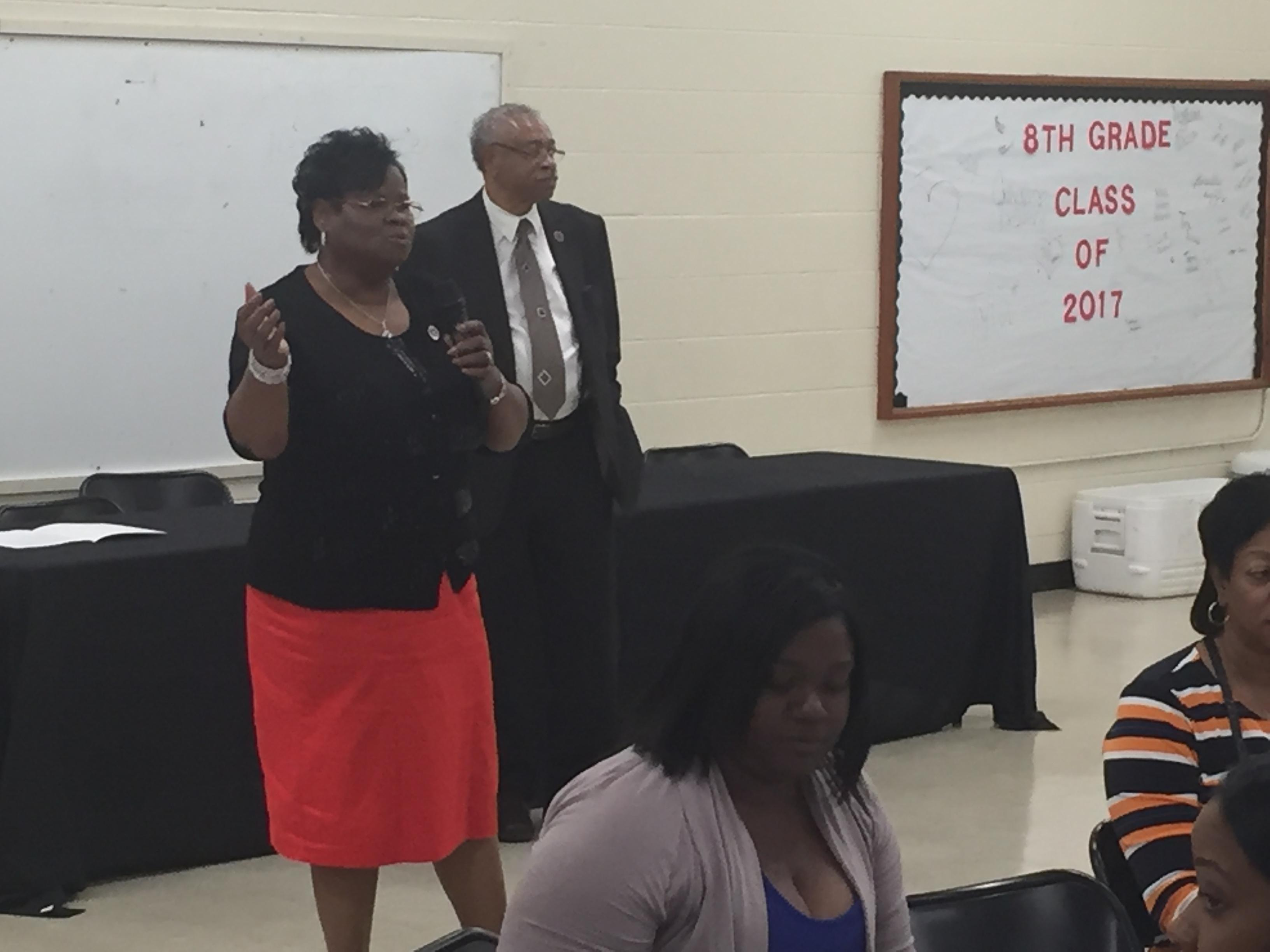 A photo of City of Baker School Board President Rosatina Johnson speaking to the employees at an end of year appreciation luncheon