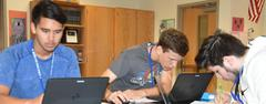 Brewer High School physics students use their school-issued Dell laptops to work on a computer-generated simulation an explore the relationships between electric fields, electric potential and distance from a source charge. WSISD was selected as a Dell Model District this year.
