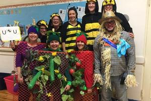McKinley principal Marc Biunno and staff dress as the school's garden, complete with scarecrow and bee pollinators, for Halloween 2018.
