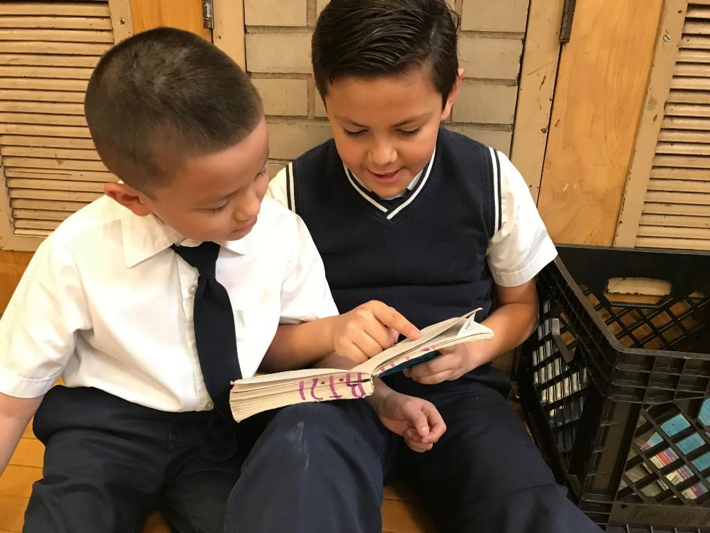 Students sharing a chapter book