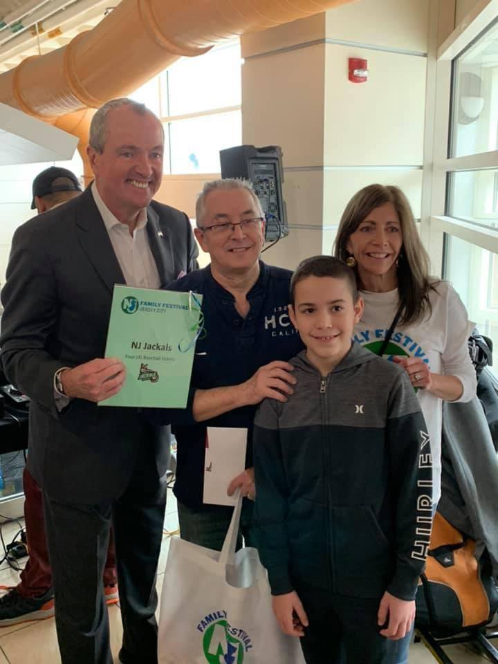 Governor Murphy and his wife with a man and his young son