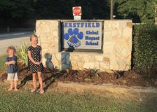 students plant flowers and pick up trash before school starts.