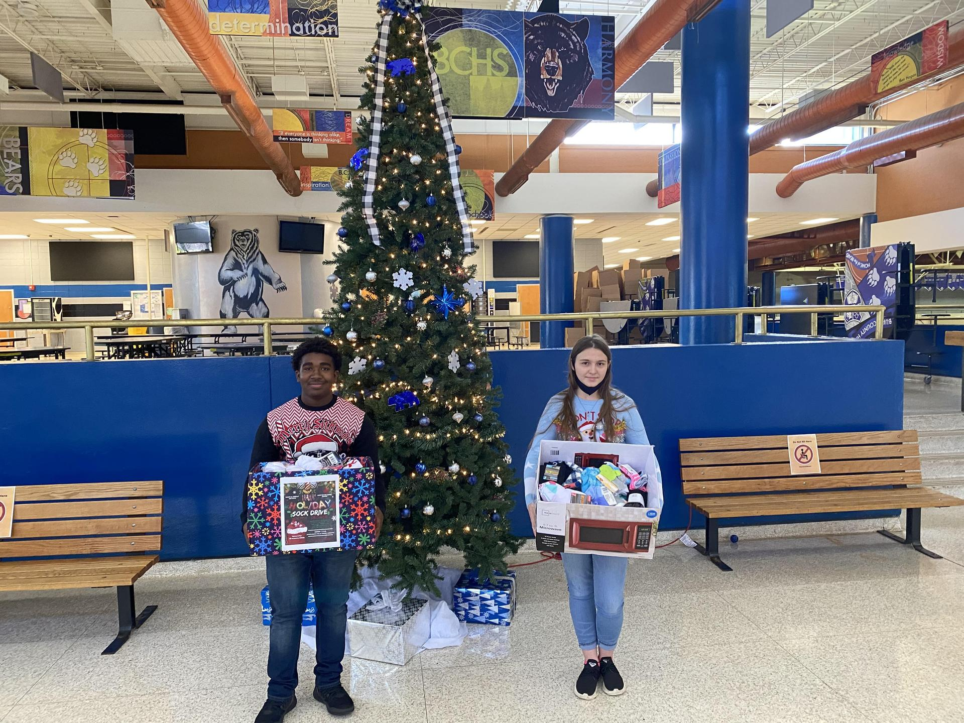 BCHS IB students learn about serving their community through a holiday sock drive.