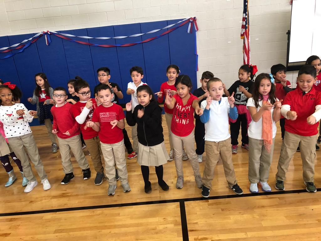 group of 2nd grade students performing their song for the audience