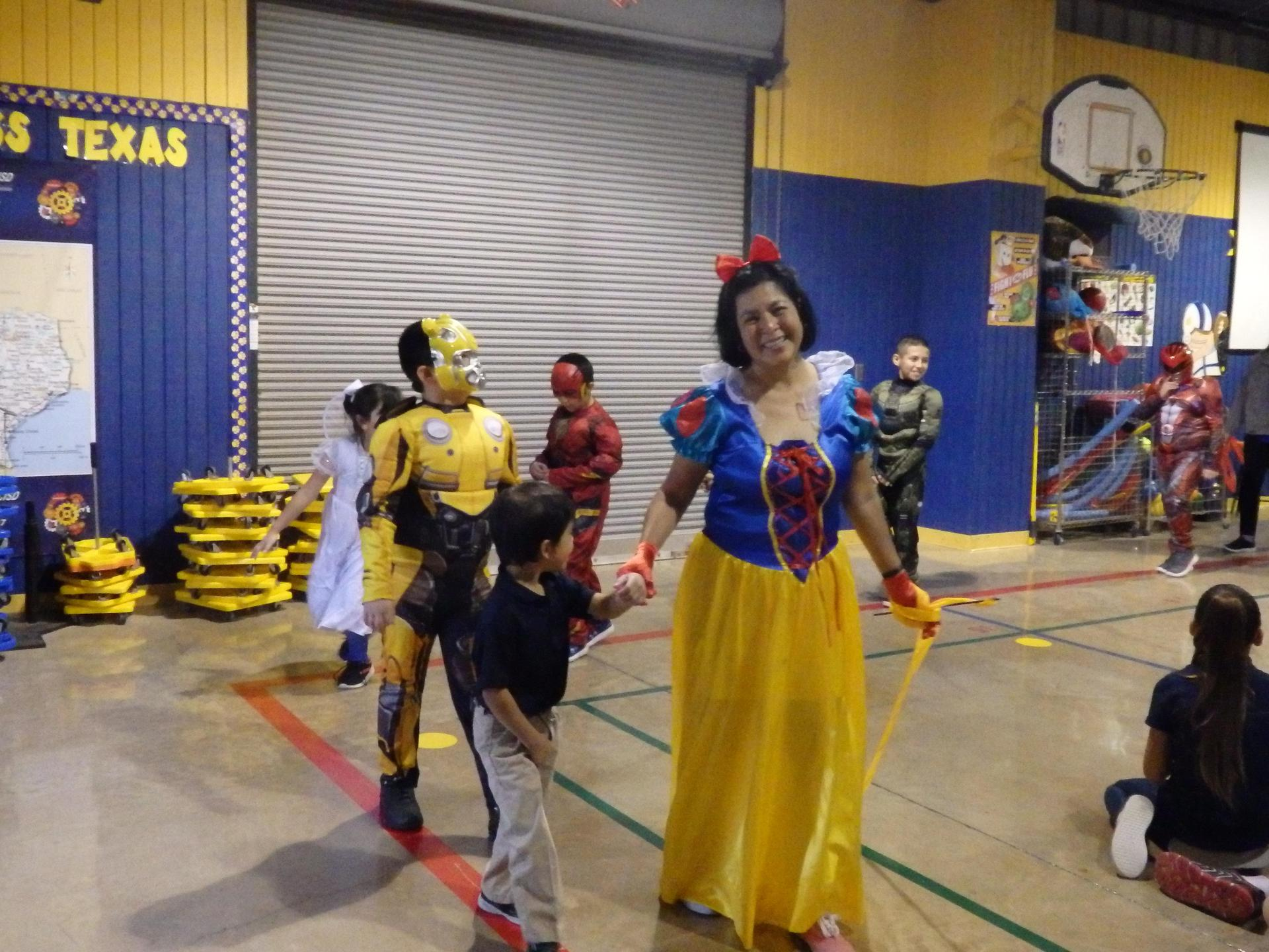 Special Ed teacher leads the halloween parade