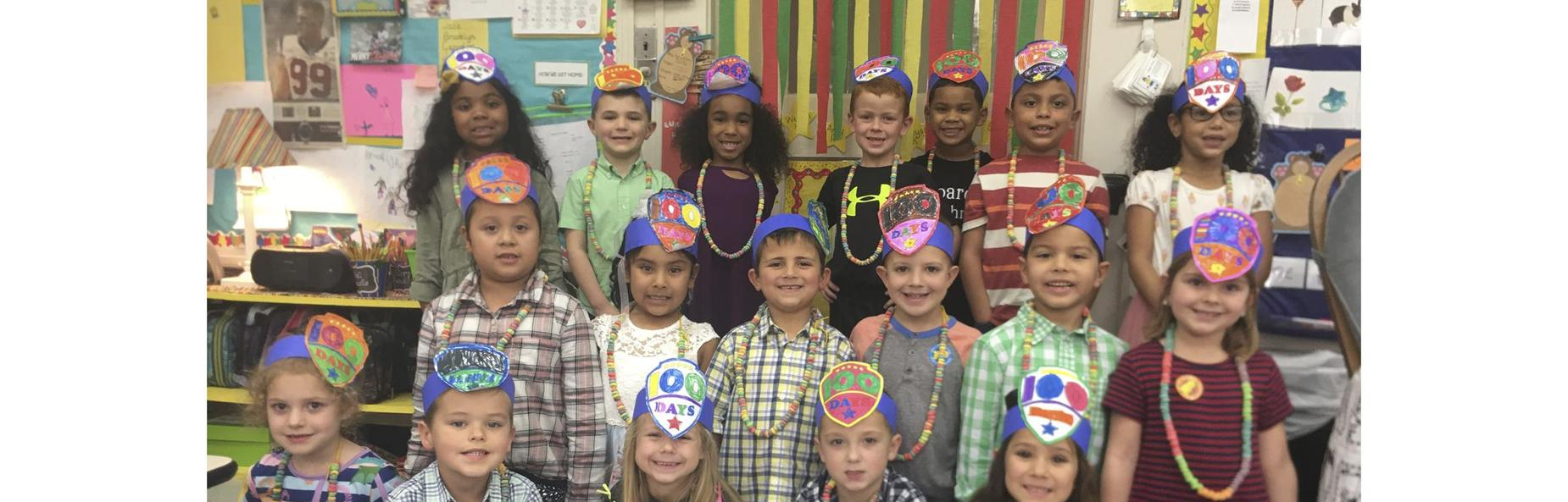 school children wearing hats celebrating one hundred days of school