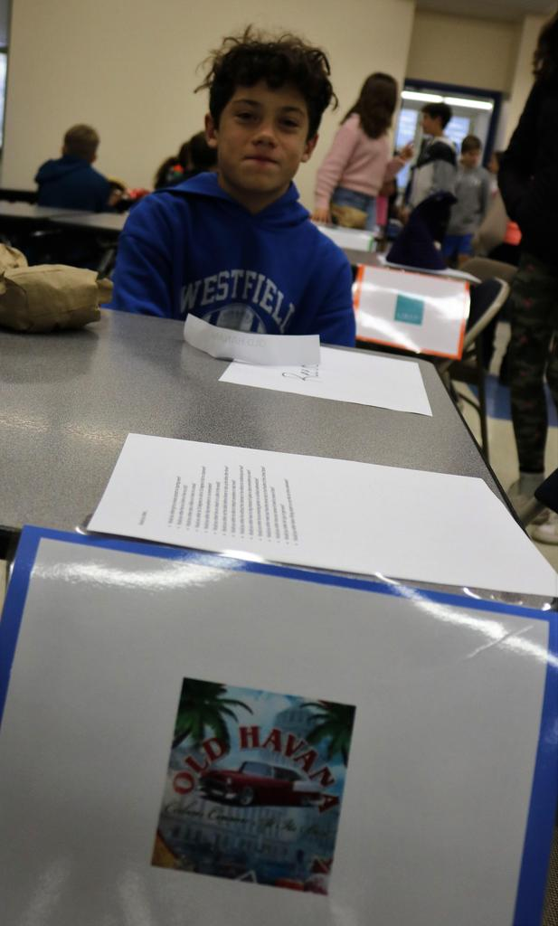 Photo of student sitting at lunch table on Mix It Up Day.