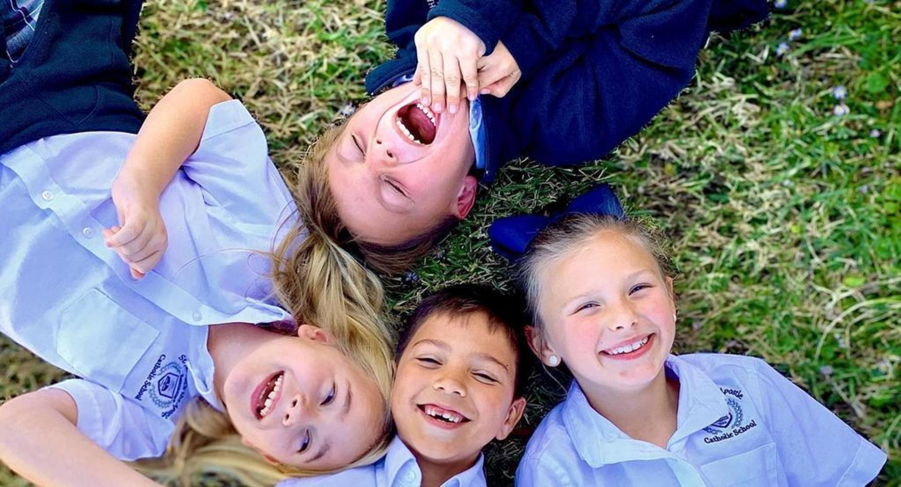 Kids lying in circle