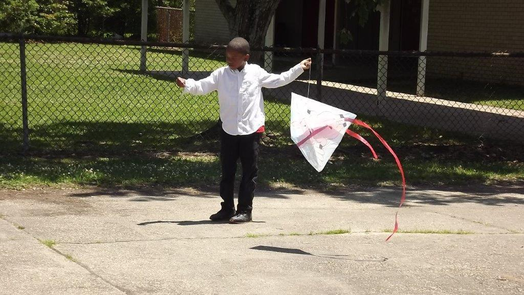 a photo of Park Ridge's students enjoying spring by flying kites outdoors