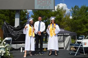 Valedictorian and salutatorian pose for a picture with BHS Assistant 12th grade principal