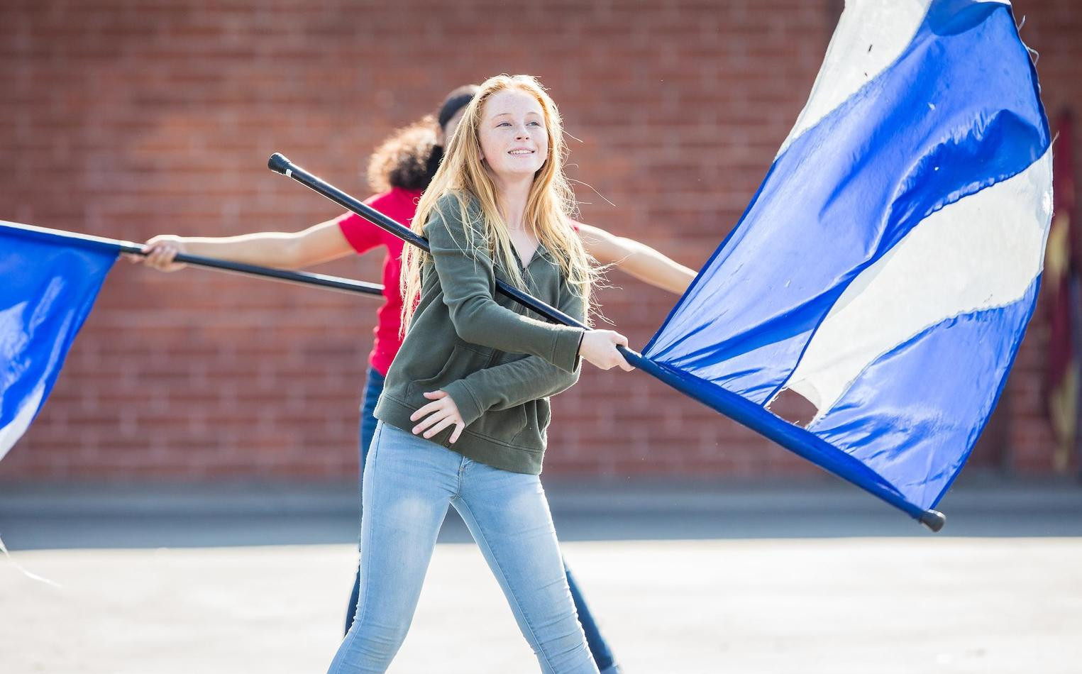 Student rehearsing her flag routine.