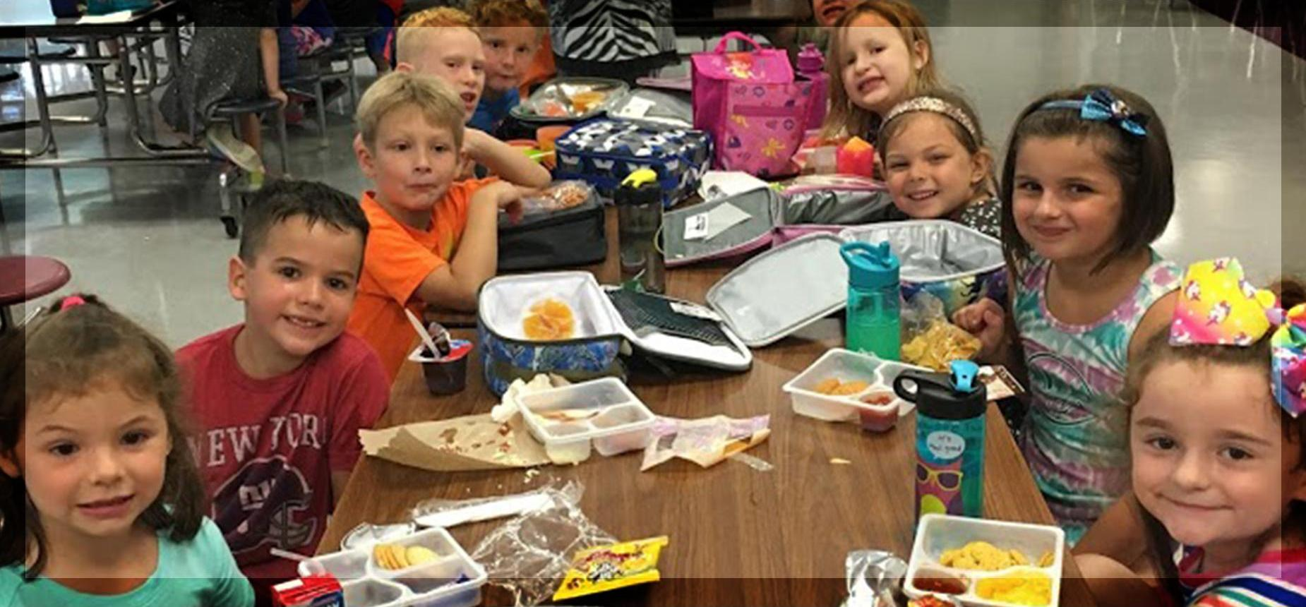 Elementary children eating lunch in cafeteria