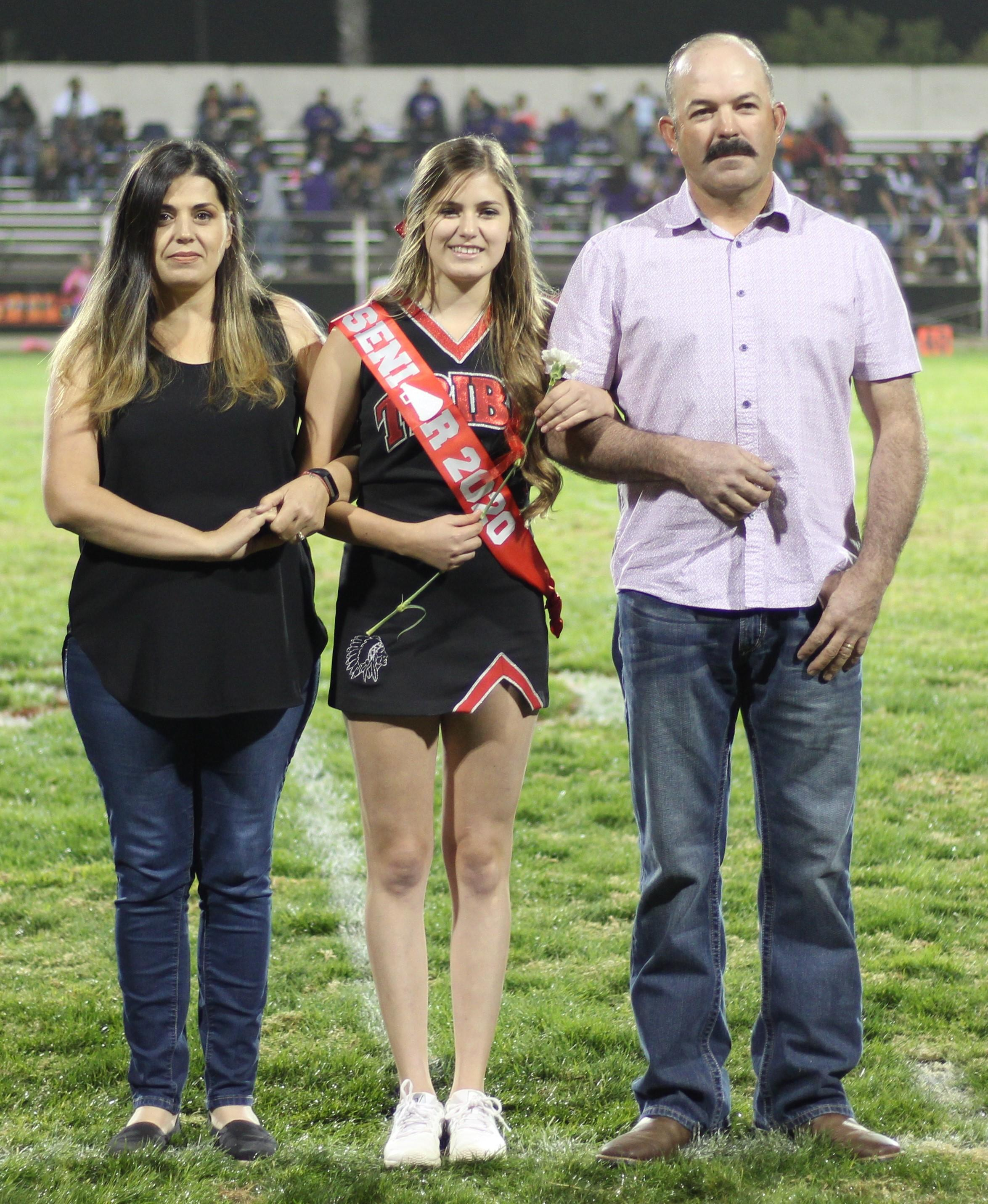Senior cheerleader Vicki Jimenez and her escorts.