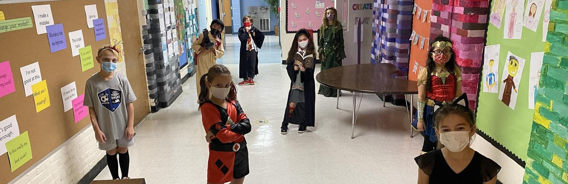 Photo of McKinley students wearing Halloween costumes (and masks to guard against COVID) and posing for a picture.