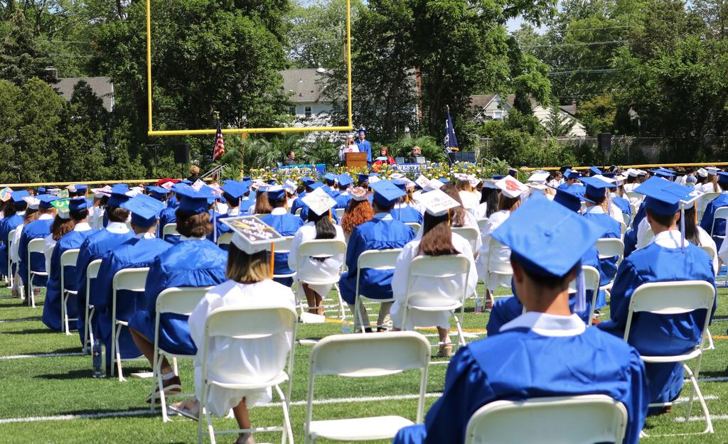 Wide photo of back of WHS 12th graders during commencement ceremony