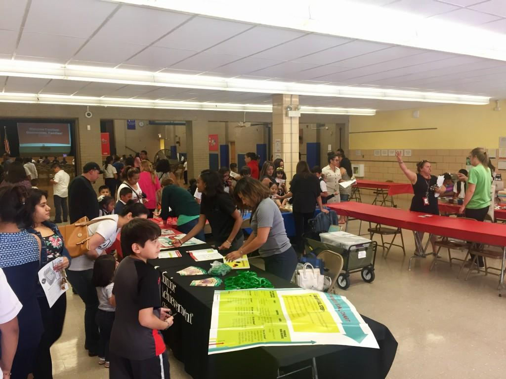 Families visit the booths in the Cafeteria at Back to School Night
