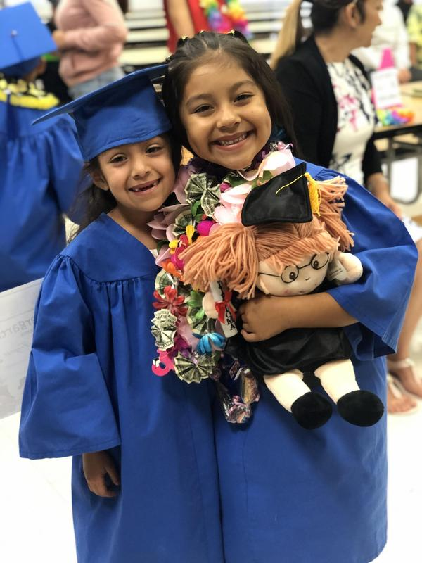 Girls graduating from Kinder.
