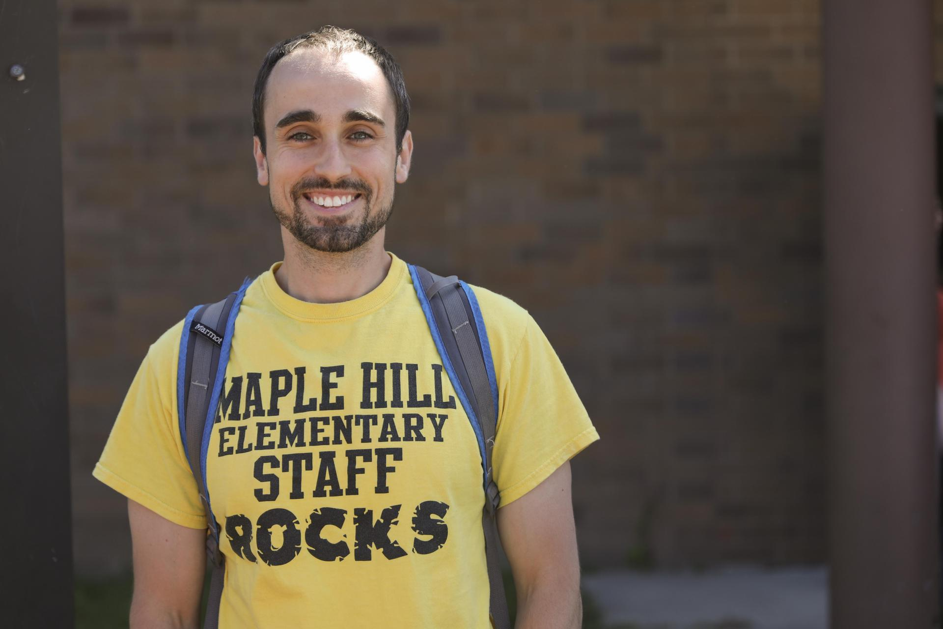 "Maple Hill Elementary School teacher wearing t-shirt that says ""Maple Hill Elementary Staff Rocks."""
