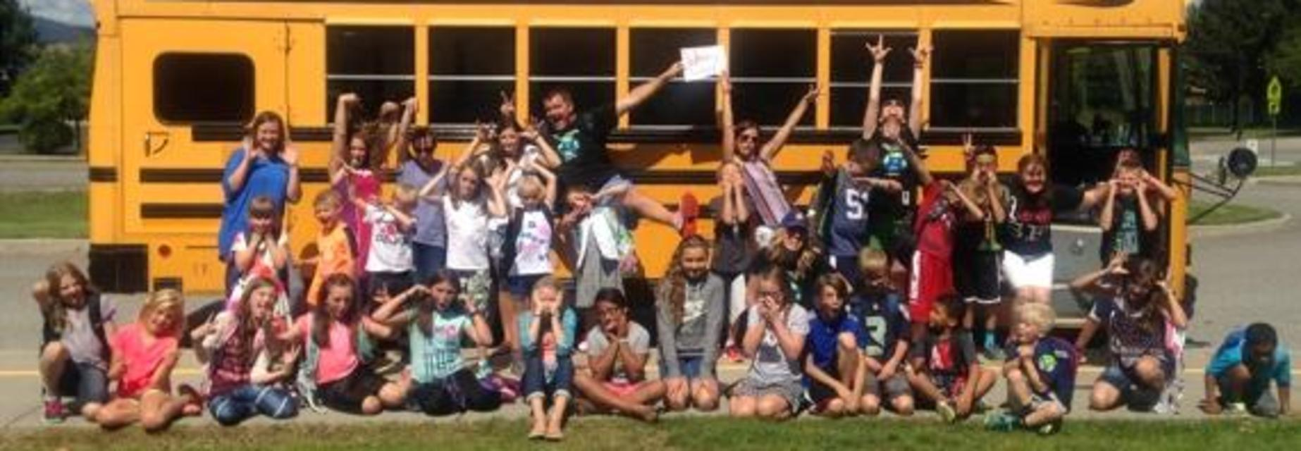silly students in front of school bus