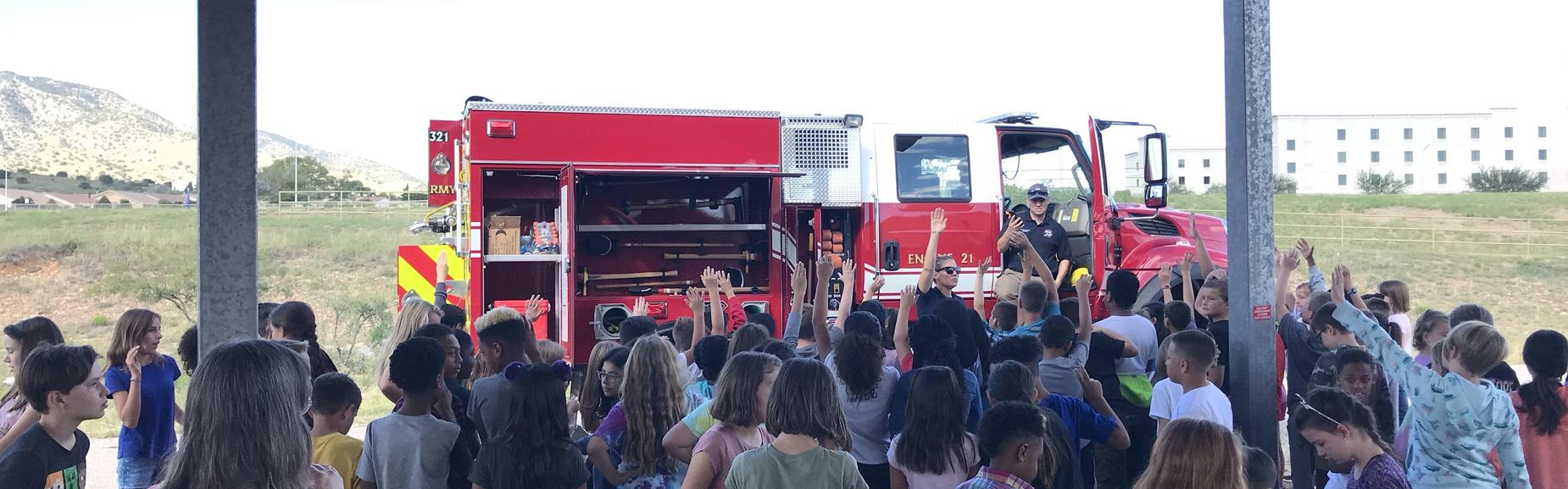 students asking firemen questions