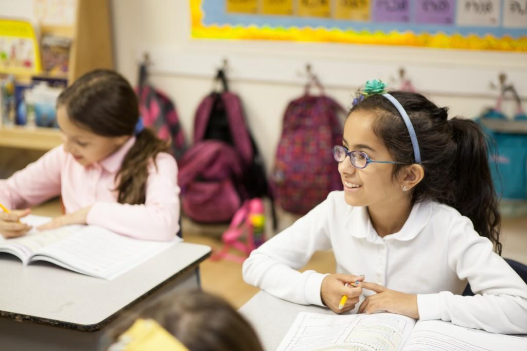 girls working in their workbooks
