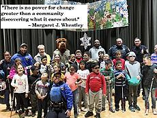 """There is no power for change greater than a community discovering what it cares about."" - Margaret J. Wheatley Image of the 49th Precint with our students after a anti-bullying assembly"