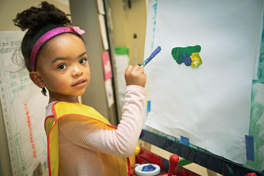 HudsonWay Immersion School Preschooler painting in an art classroom