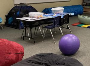 Bean Bag chairs, table with sensory items, exercise ball, tent