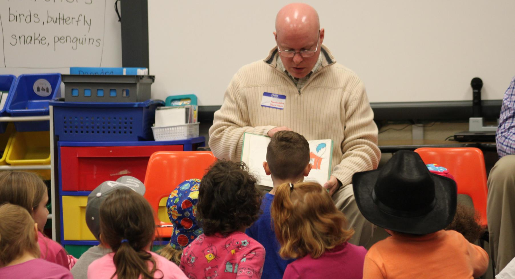 Representative Hawk reads to students.