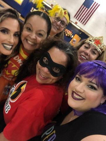 female teachers grouped for a photo in costumes