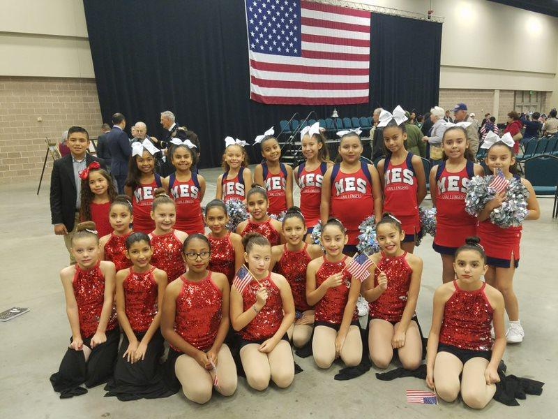 cheerleaders posing at event.