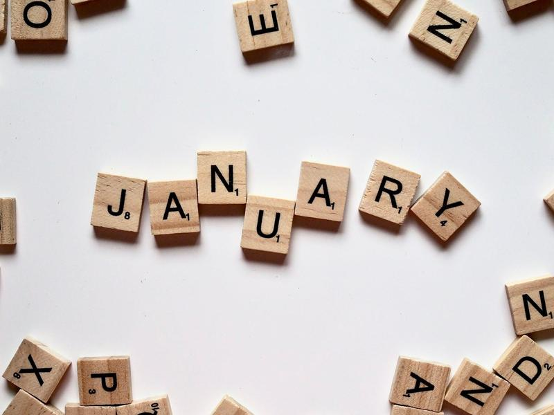 Scrabble tiles spelling the word January