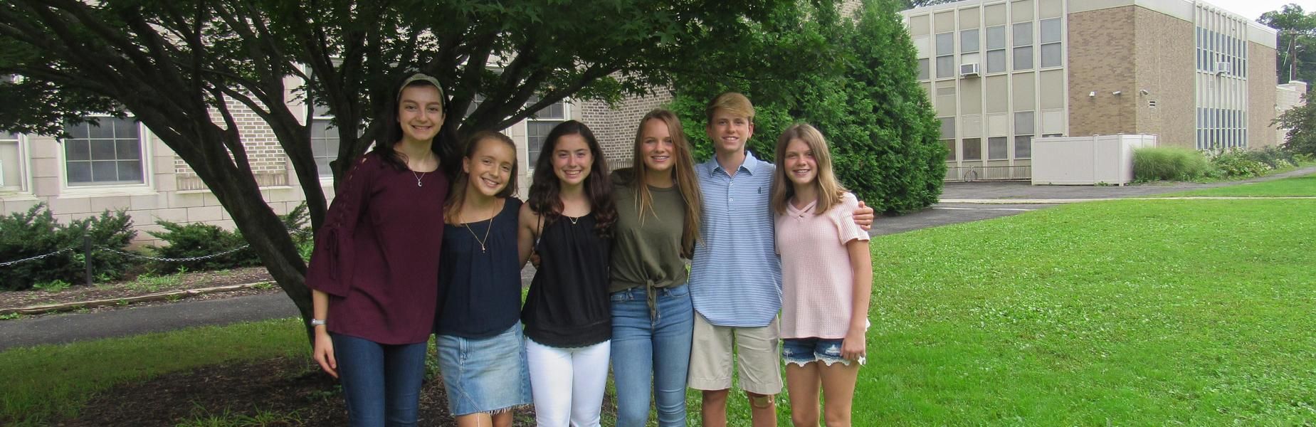 Members of the Roosevelt Intermediate School student council pose for a picture outside of the school.