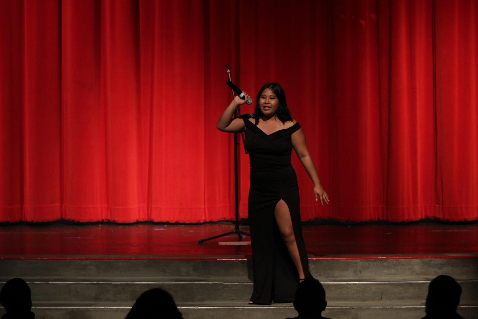 Bianca Solidum singing at the talent show