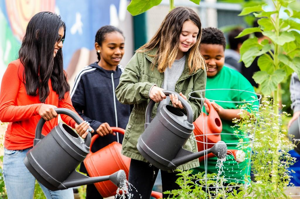 Students watering plants.