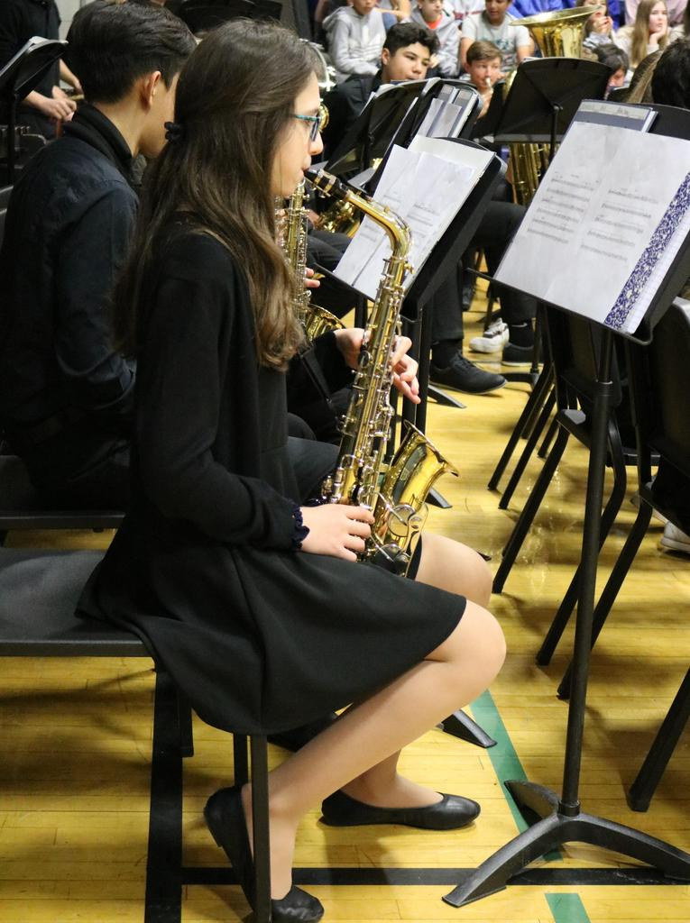 Photo of Roosevelt band students performing at Veterans Day assembly.