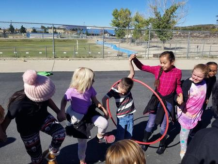 Students working together with Hula Hoop