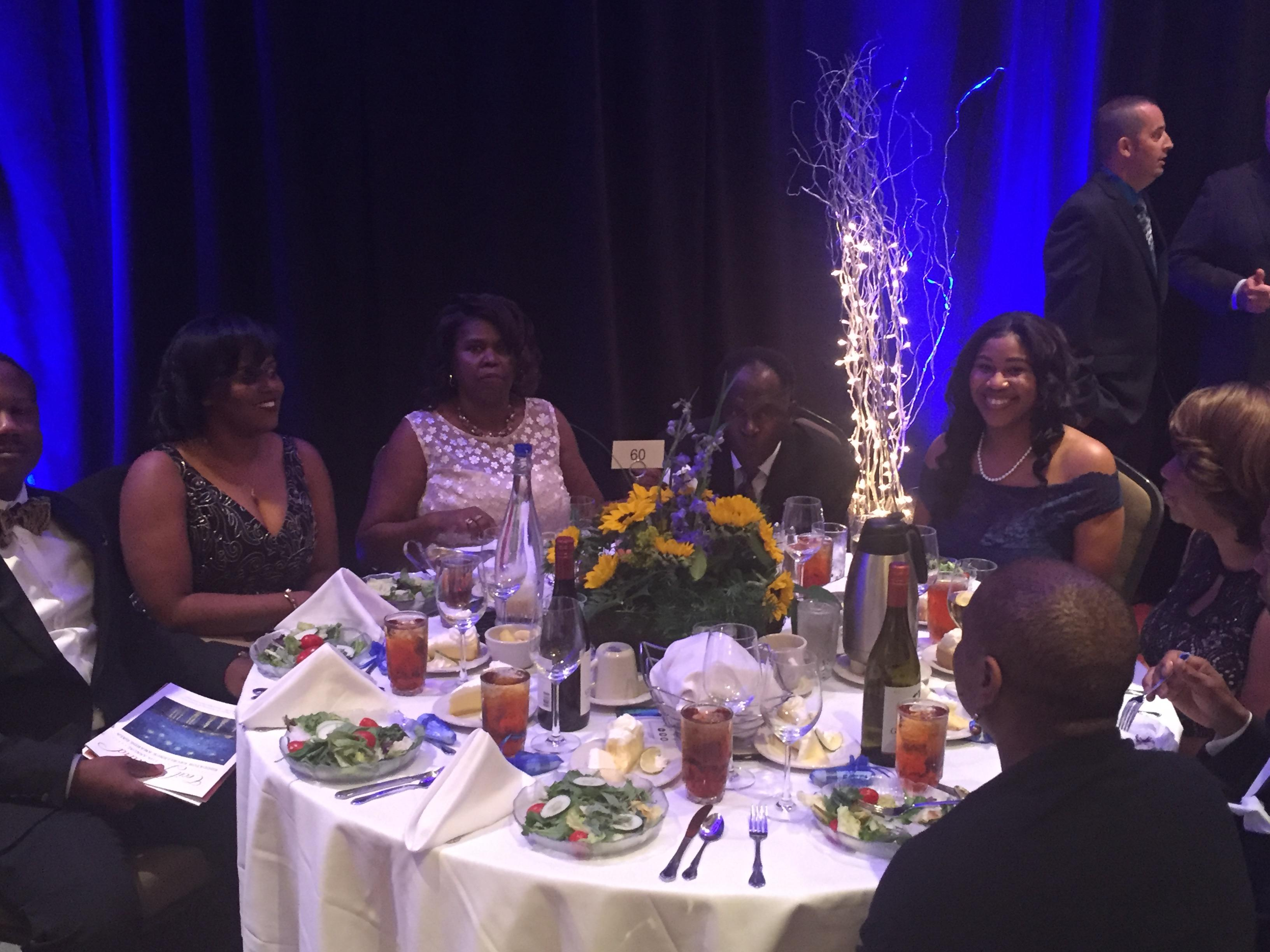Photo of Principal Penn and table of invited guests at the state sponsored gala honoring educators from across the state
